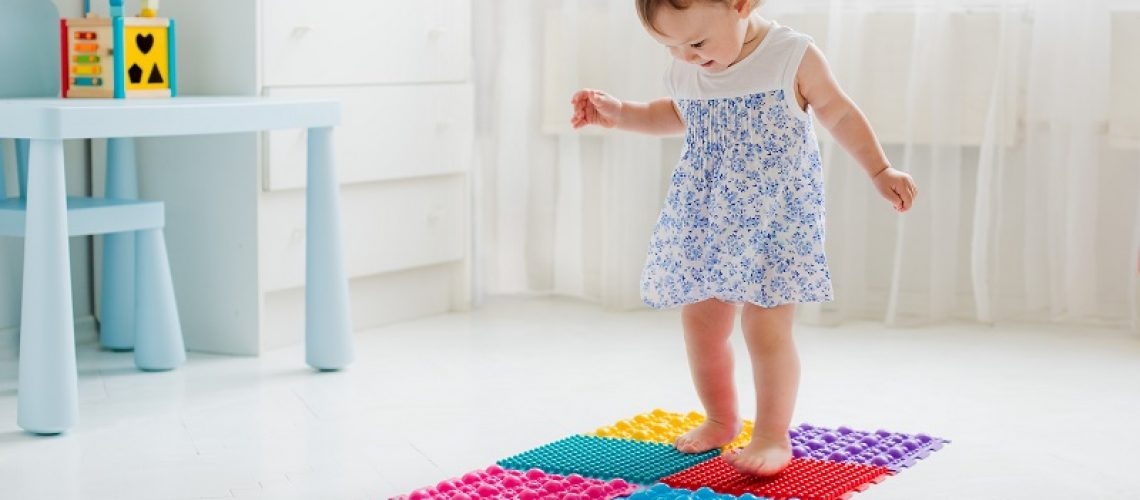little girl walking on massage Mat